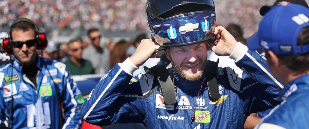 PHOTO: In this file photo, Dale Earnhardt Jr. puts on his helmet beside his race car during the Daytona 500 on Sunday, Feb. 26, 2017, at Daytona International Speedway in Daytona Beach, Fla.