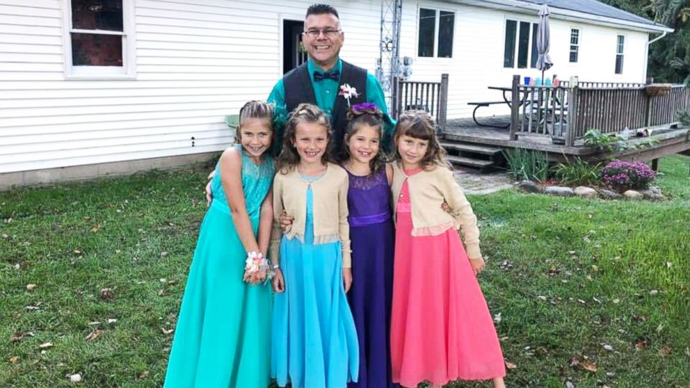 Steve Culbert, a teacher from Davidson, Michigan, escorted his former students Alivia Reece, 7 (in coral) and Avery Reece, 8 (in blue), to the father daughter dance along with his own daughters, Aliyah Culbert, 6 (in purple) and Hailey Culbert, 8 (in green).
