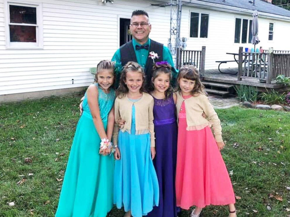PHOTO: Steve Culbert, a teacher from Davidson, Michigan, escorted his former students Alivia Reece, 7 (in coral) and Avery Reece, 8 (in blue), to the father daughter dance along with his own daughters, Aliyah Culbert, 6 (in purple) and Hailey Culbert, 8.