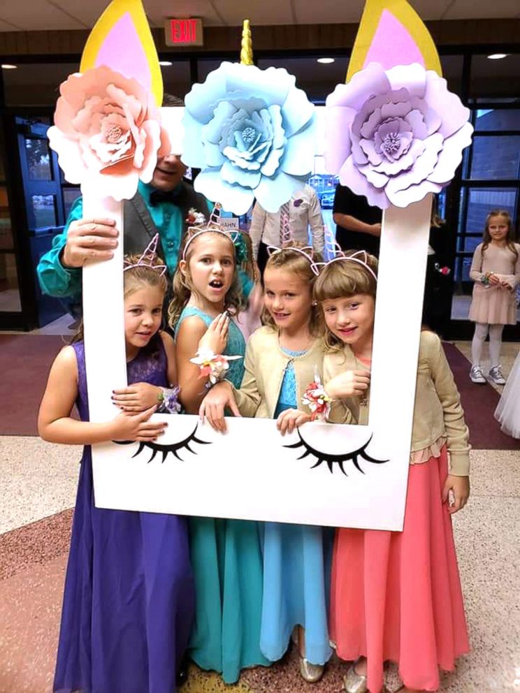 PHOTO: Alivia Reece, 7 (in coral) and Avery Reece, 8 (in blue), to the father daughter dance along with his own daughters, Aliyah Culbert, 6 (in purple) and Hailey Culbert, 8 (in green), attended the father daughter dance together.