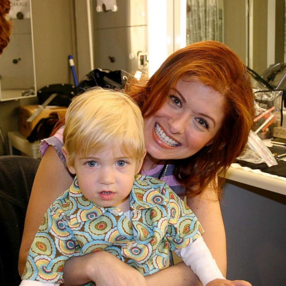 PHOTO: Debra Messing with her son Roman, 1, on the set of Will and Grace.