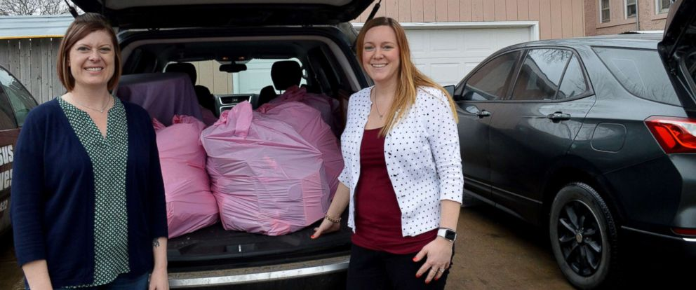 PHOTO: Lynne Hilton, left, and Jenni DeWitt prepare to donate items from their homes.