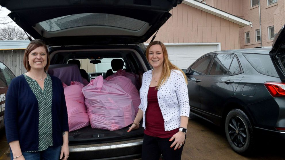 Lynne Hilton, left, and Jenni DeWitt prepare to donate items from their homes.