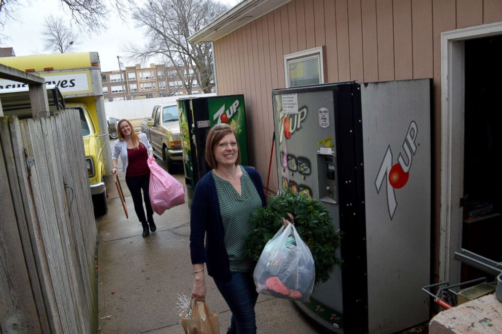 Lynne Hilton, right, and Jenni DeWitt prepare to donate items from their homes.
