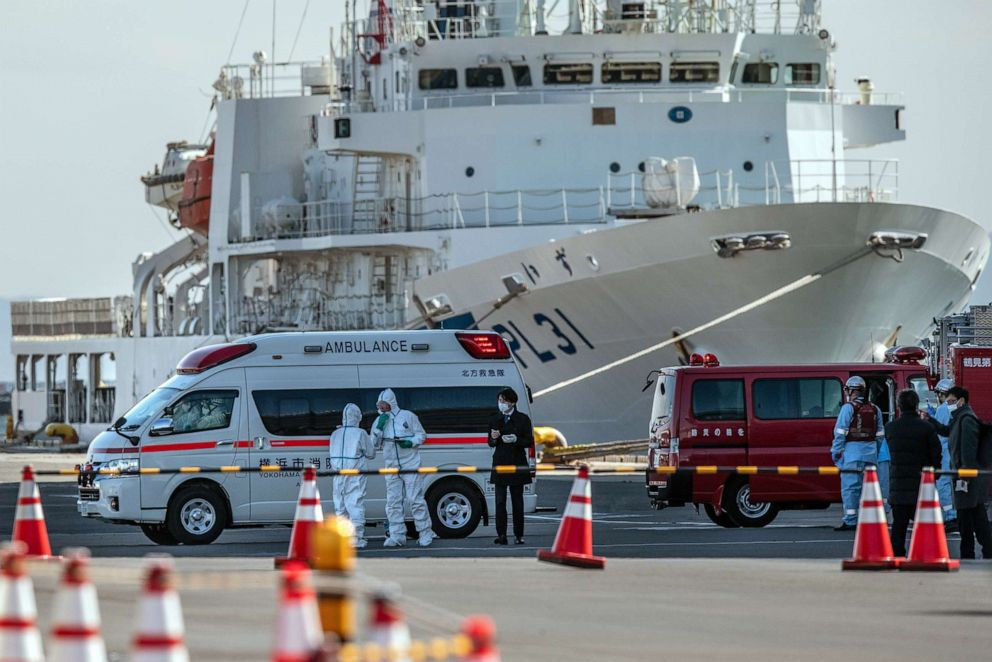 PHOTO: An ambulance carries a coronavirus victim from the Diamond Princess while it is docked at Daikoku Pier, as the ship remains in quarantine after a number of the 3,700 people on board came down with the virus, Feb. 6, 2020 in Yokohama, Japan.