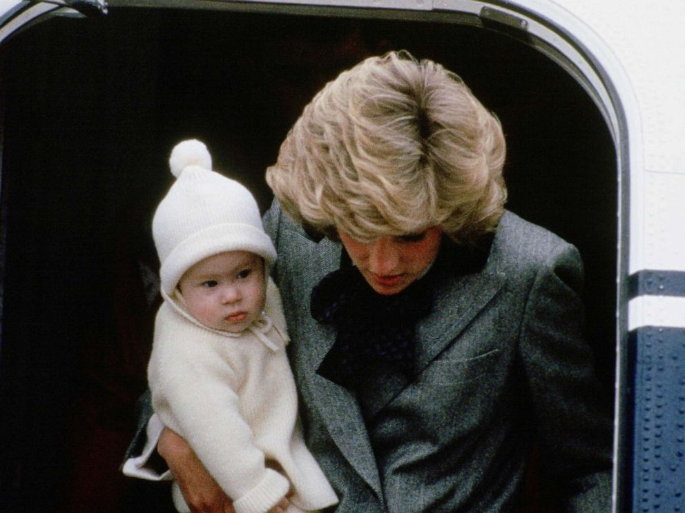 PHOTO: Diana, Princess of Wales carries her son, Prince Harry, off a flight at Aberdeen Airport, Scotland.