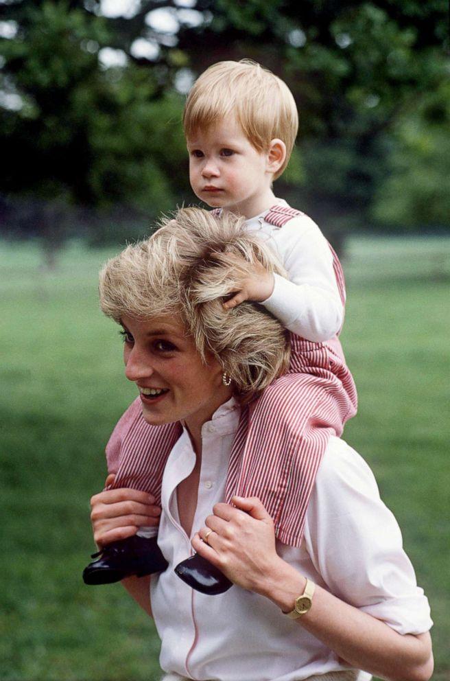PHOTO: Princess Diana carries Prince Harry on her shoulders at Highgrove in Tetbury, U.K., July 18, 1986.