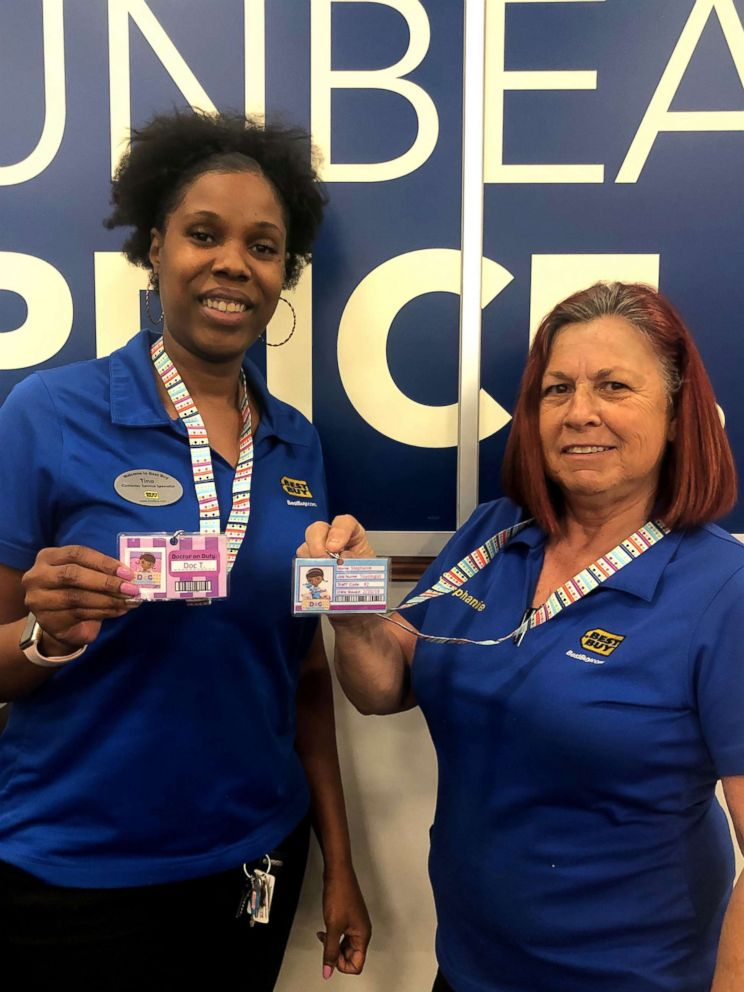 "Best Buy employees T and Stephanie sporting their new ""Dino Doctor"" Best Buy badges."