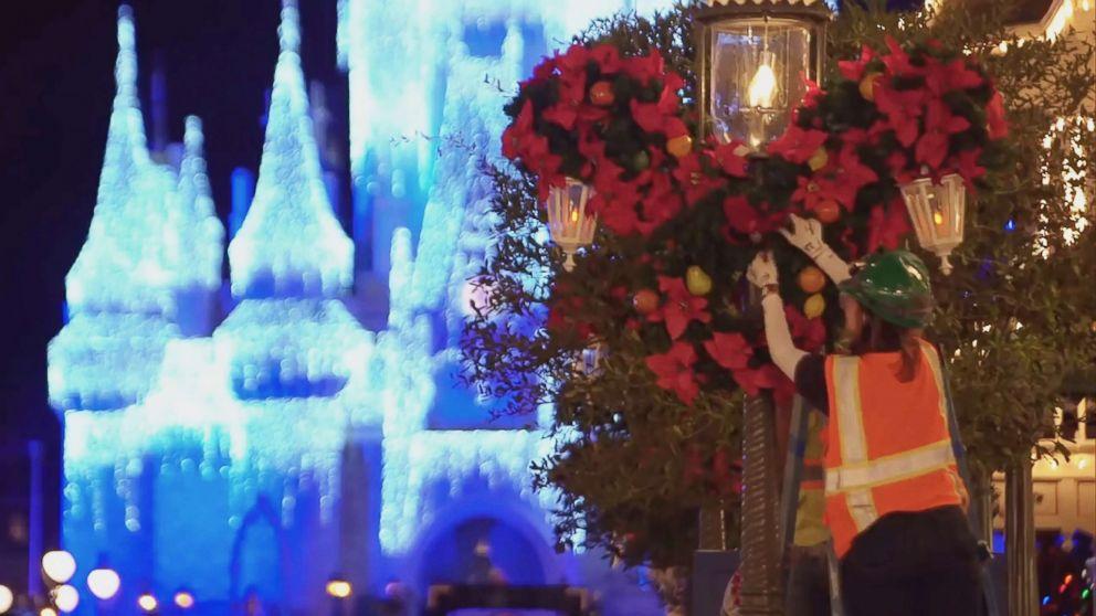 PHOTO: Walt Disney World teams decorate Magic Kingdom for the holidays.
