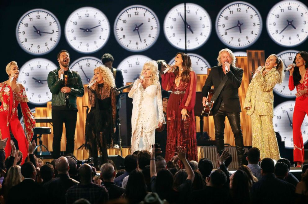 PHOTO: Katy Perry, Phillip Sweet, Karen Fairchild, Dolly Parton, Kimberly Schlapman, Jimi Westbrook, Miley Cyrus and Kacey Musgraves perform 9 to 5, at the 61st Grammy Awards, Feb. 10, 2019.