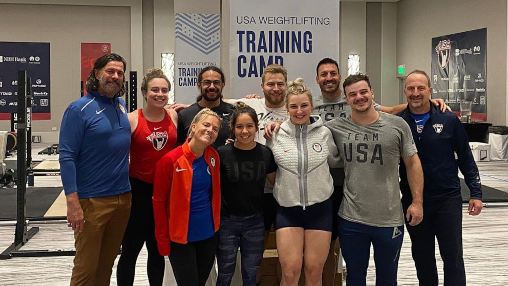 Dr. Jeffrey Durmer poses with the U.S. Weightlifting team.