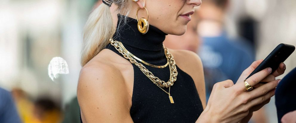 PHOTO: A woman is seen wearing jewelry: golden earrings, necklace and ring, during Paris Fashion Week, Sept. 30, 2019 in Paris.