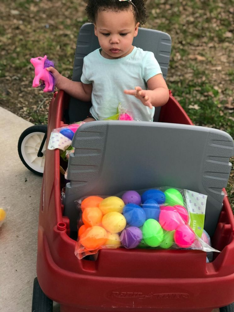PHOTO: Delaney Drake, 2, is seen with the Easter eggs that her parents, Josh and Blakeley Drake of Manchester, Tenn., will plant in the yards of local families.