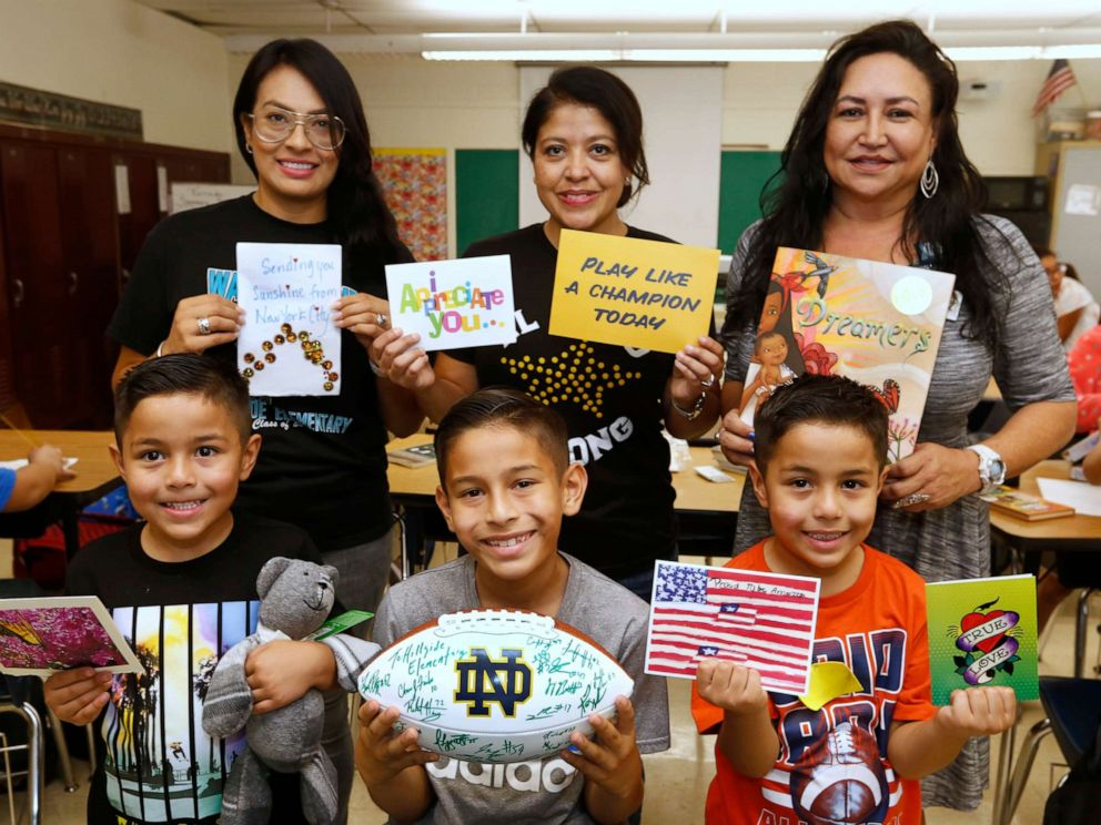 PHOTO: Elvira Flores, standing center, poses with students and colleagues at Hillside Elementary.