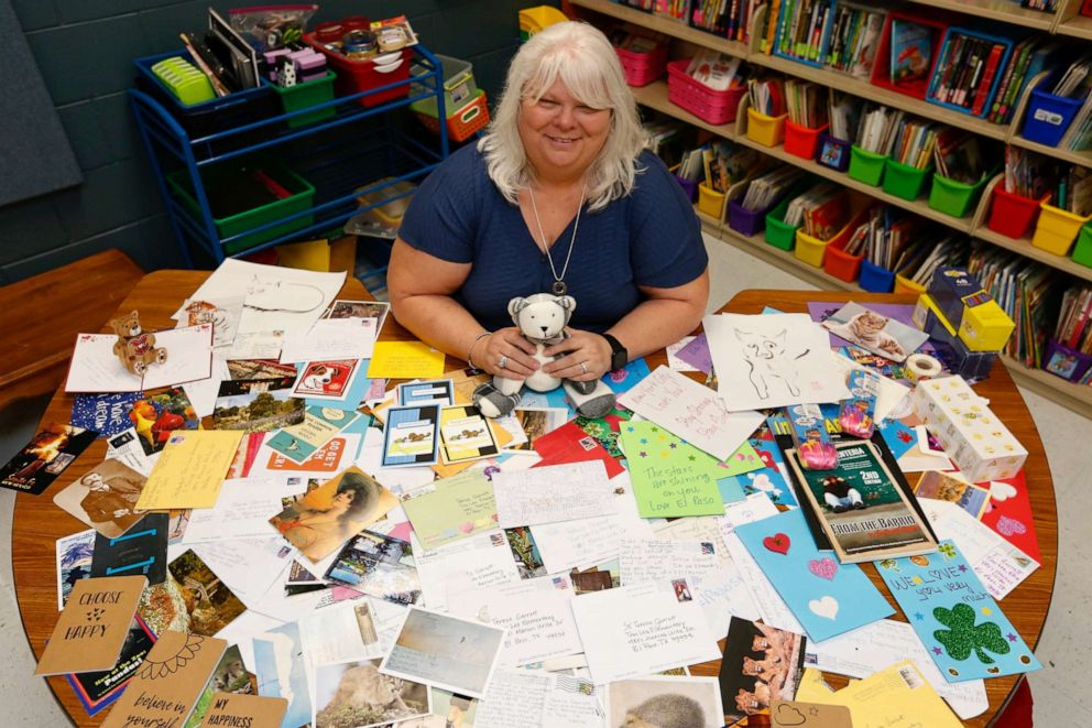 PHOTO: Tom Lea Elementary School teacher Teresa Garrett poses with postcards the school has received.