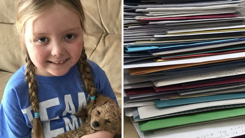 """Emma Mertens, 7, of Wisconsin, was diagnosed with a brain tumor on Jan. 23, 2019. Emma has been receiving letters from """"dogs"""" around the world after her parents' friends kicked off a viral campaign."""