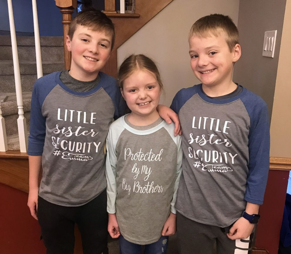 Emma Mertens, 7, is photographed with her brothers Carter, 12 and Cameron, 10, in an undated file photo.