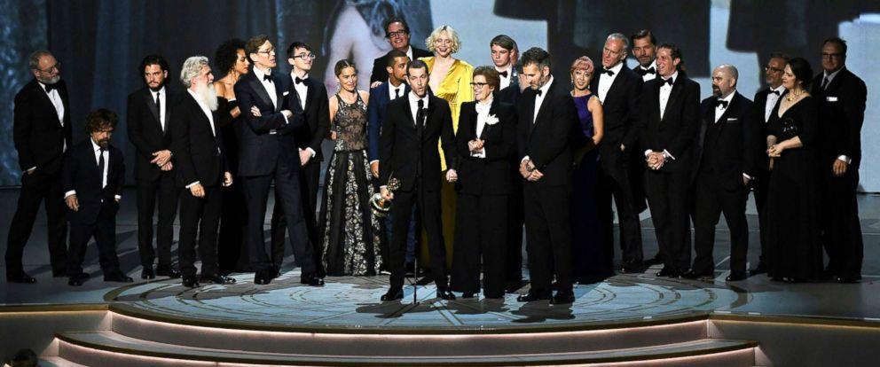 "PHOTO:Writer-producer D.B. Weiss (C-L) and the cast of ""Game of Thrones"" accept the award Outstanding Drama series during the 70th Emmy Awards in Los Angeles, Sept. 17, 2018."