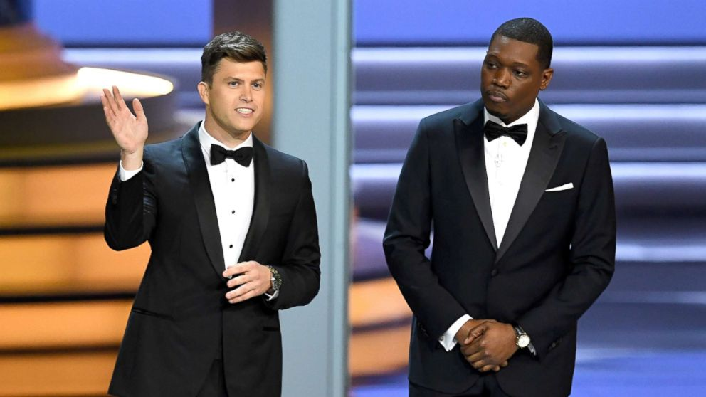 Colin Jost (L) and Michael Che speak onstage during the 70th Emmy Awards at on Sept. 17, 2018, in Los Angeles.