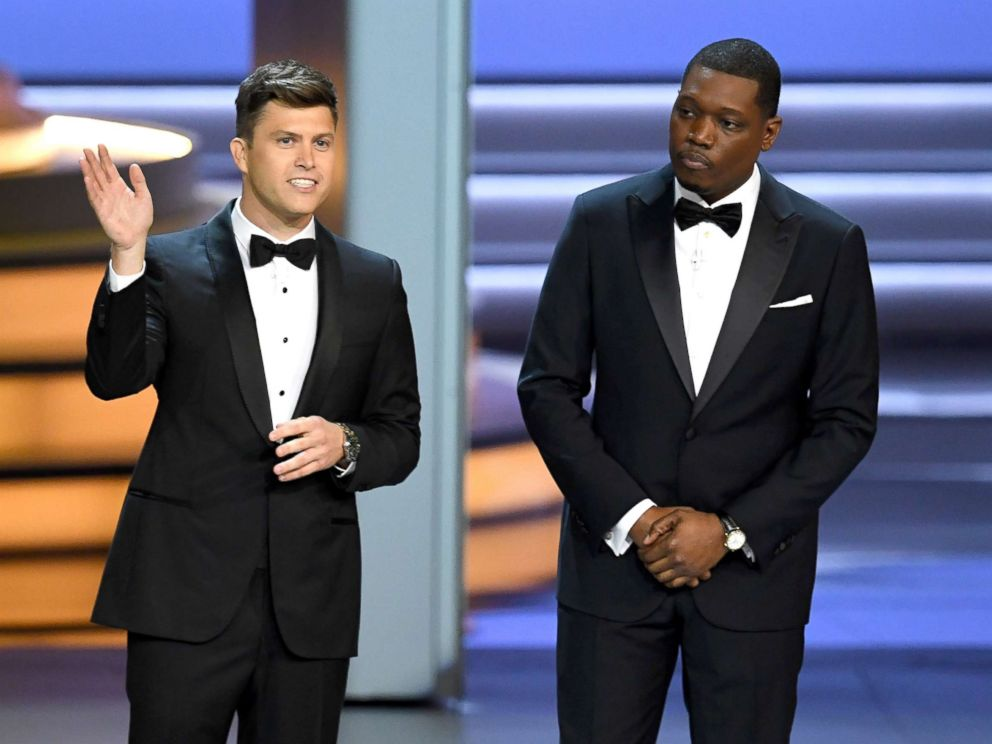 PHOTO: Colin Jost (L) and Michael Che speak onstage during the 70th Emmy Awards at on Sept. 17, 2018, in Los Angeles.