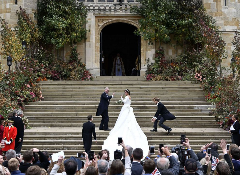 Princess Eugenie arrives accompanied by the Duke of York, at St Georges Chapel for her wedding to Jack Brooksbank in Windsor Castle in London, Oct. 12, 2018.