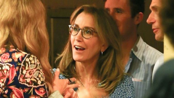 Felicity Huffman all smiles at daughter's high school graduation