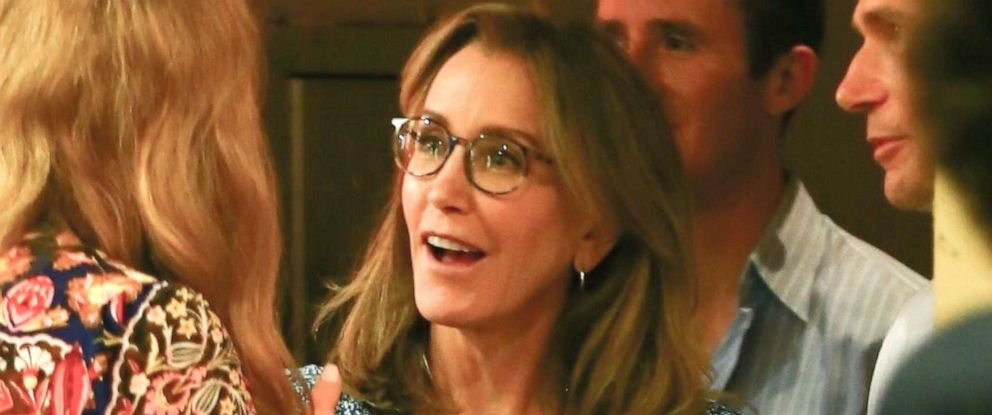 PHOTO: Felicity Huffman chats with friends and family after attending her daughter Sofia Graces high school graduation ceremony in Hollywood, Calif., June 10, 2019.