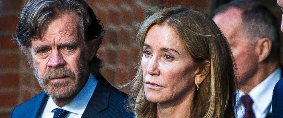 PHOTO: In this Sep. 13, 2019 file photo Felicity Huffman right, and her husband, William H. Macy, walk out of the John Joseph Moakley United States Courthouse in Boston.