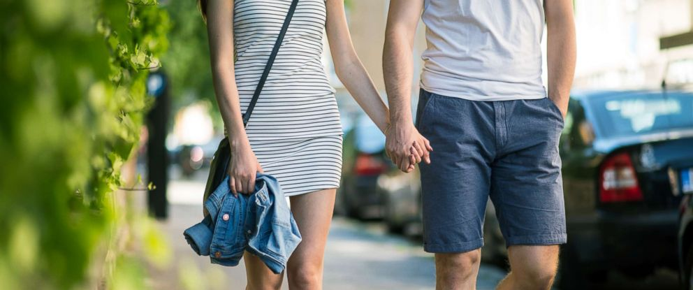 PHOTO: A couple hold hands while on a date in this stock photo.