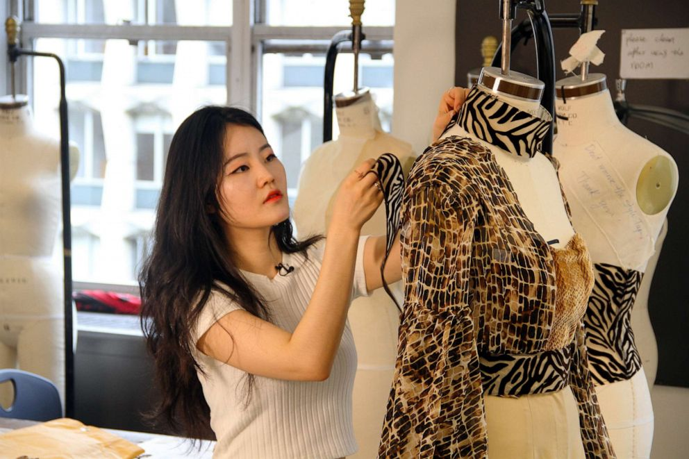 PHOTO: Seohee Ruby Shin (FIT student) works on design for Nala (The Lion King) inspired garments.