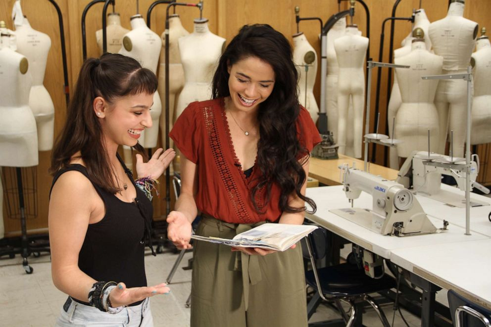 PHOTO: Annette Stone (FIT student) and Arielle Jacobs (Jasmine, Aladdin) review design sketches for Jasmine inspired garments.