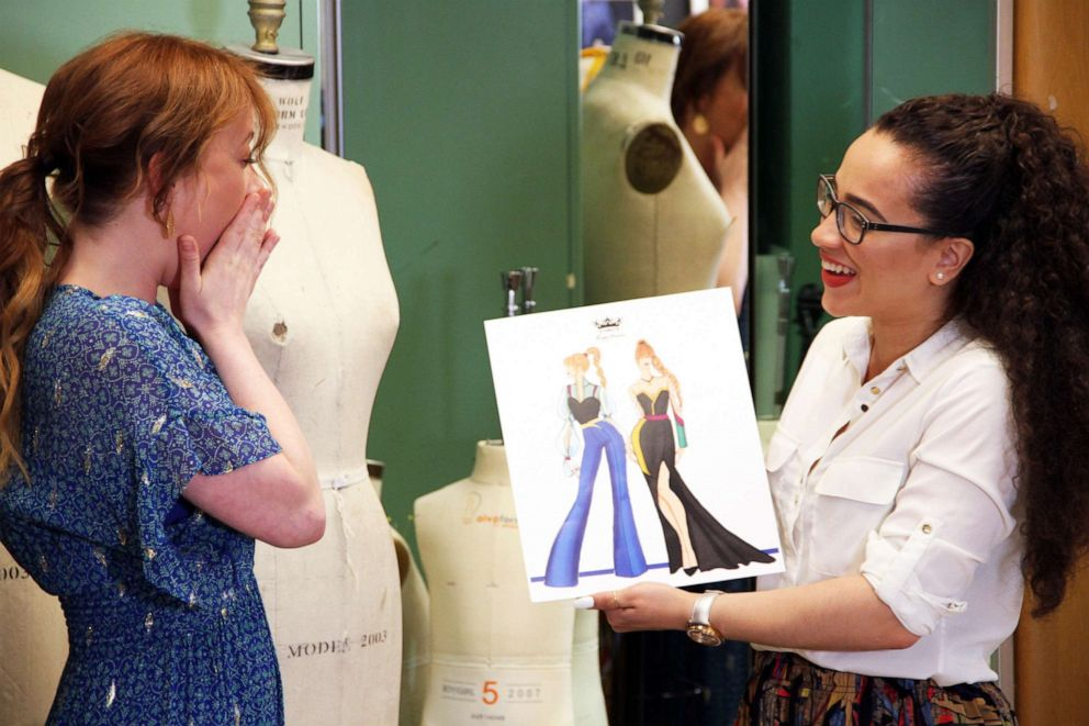 PHOTO: Patti Murin (Anna, OBC Frozen) and Yelayny Placencia (FIT student) review design sketches for Anna inspired garments.