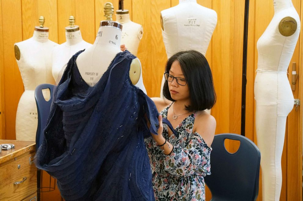 PHOTO: Baoqing Yu (FIT student) works on design for Ariel (The Little Mermaid) inspired garments.