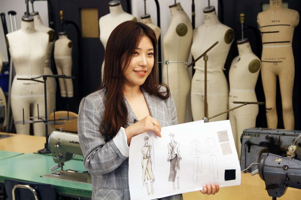 PHOTO: Sooyoung Yun, FIT student, displays design sketches for Mary Poppins inspired garments.