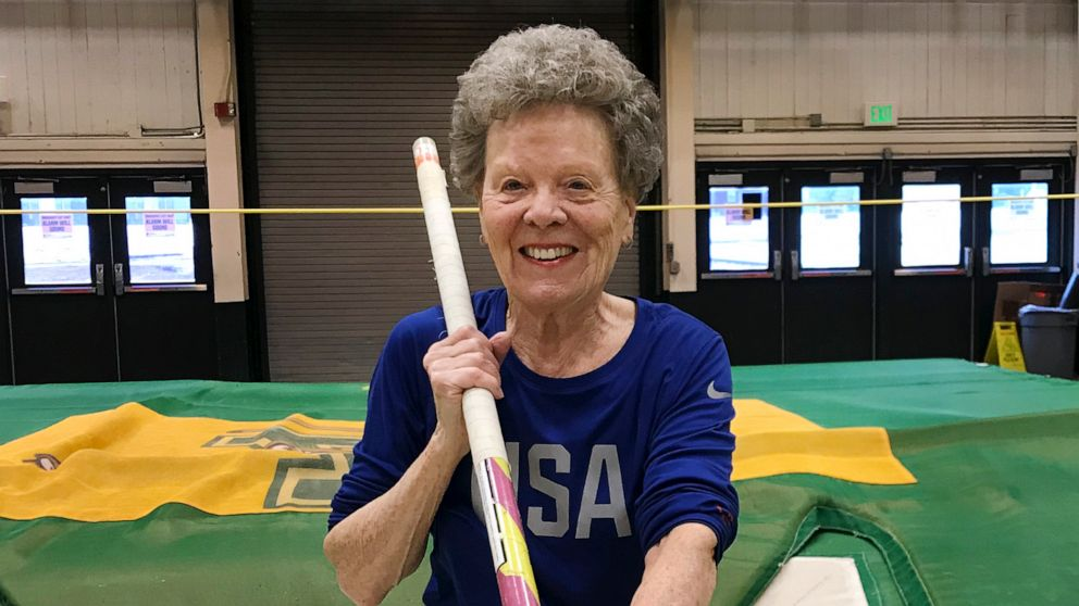 """Florence """"Flo"""" Filion Meiler, an 84-year-old record-setting pole vaulter, poses while training at the University of Vermont indoor track in Burlington, Vt., March 13, 2019."""