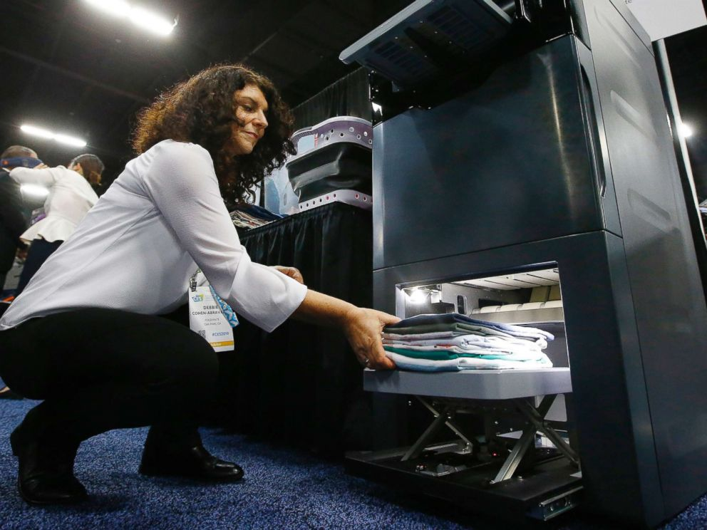 PHOTO: Debbie Cohen-Abravanel, CMO at Foldimate, demonstrates the new device that folds your clothes automatically, during the preview at CES 2019, Jan. 6, 2019, in Las Vegas, Nevada.