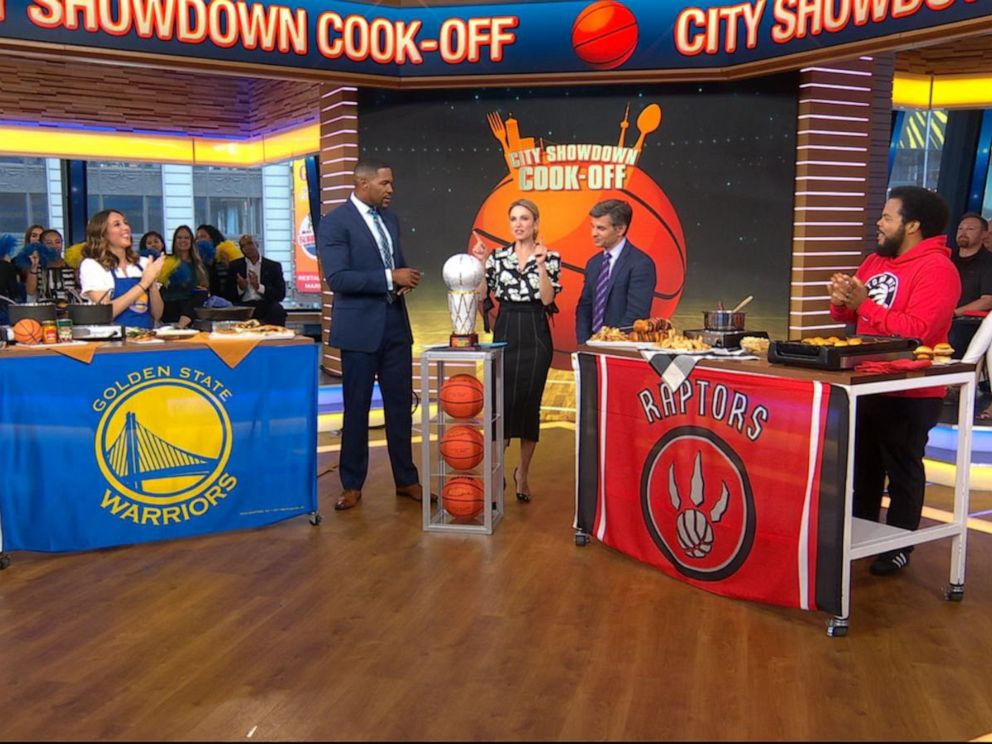 PHOTO: Toronto Raptors fan Roger Mooking, right, and Golden State Warriors fan Leah Cohen share recipes for the NBA Finals.