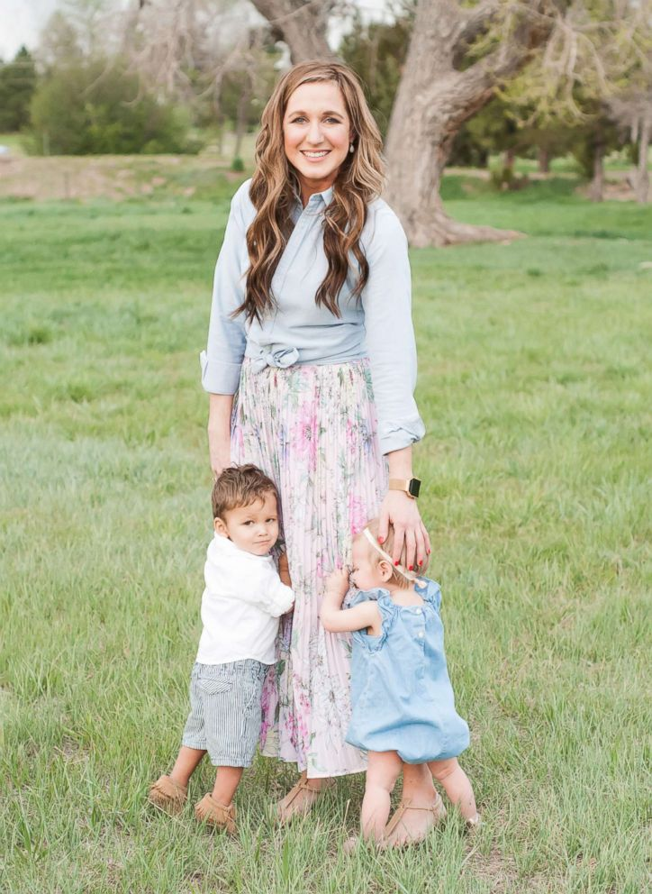 Katie Page of Parker, Colorado, photographed with her newly adopted children, Grayson, 2 and Hannah, 1.