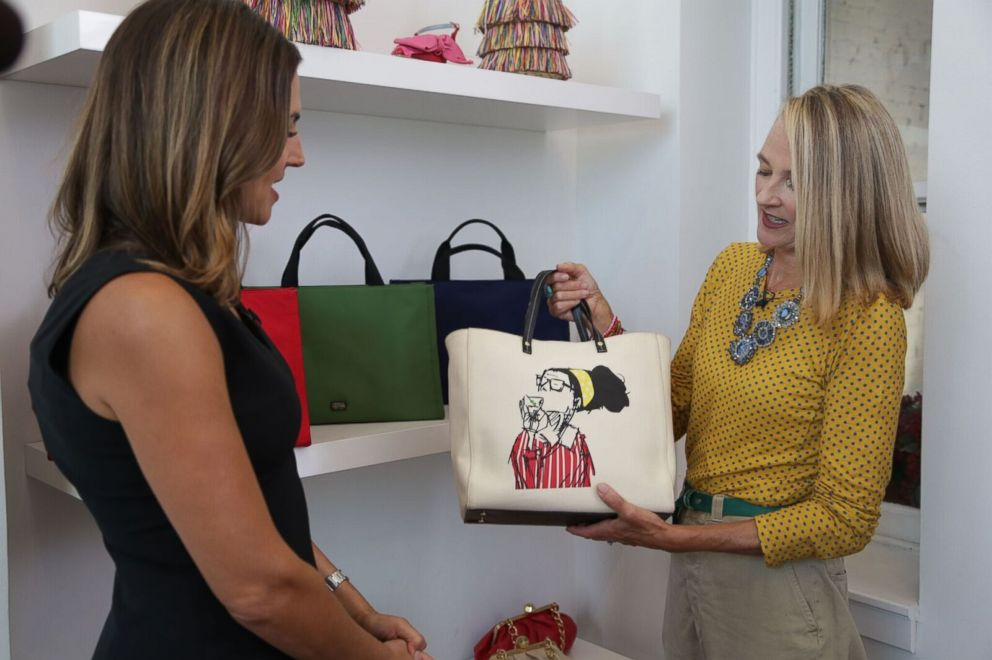 PHOTO: Elyce Arons, right, shows off a handbag with a drawing of her friend, the late Kate Spade, to ABC News Paula Faris, left.