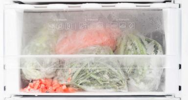 PHOTO: Freezer with open door and frozen food
