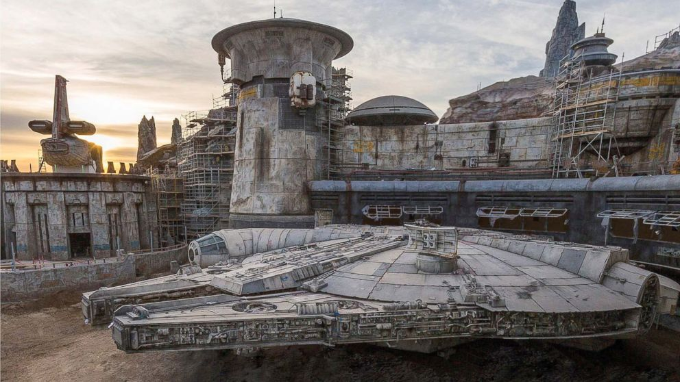 The completed Millennium Falcon sits amid Star Wars: Galaxy's Edge buildings still under construction at Disneyland in this image released in December 2018.