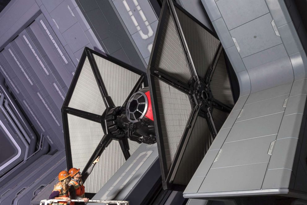 PHOTO: Disney Imagineers view a life-size TIE fighter as they work on Star Wars: Rise of the Resistance at Star Wars: Galaxys Edge.