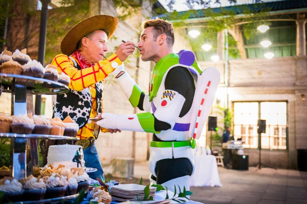 PHOTO: Grooms Garrett Smith and Jason Bitner dressed as Woody and Buzz Lightyear at Disney-themed wedding.
