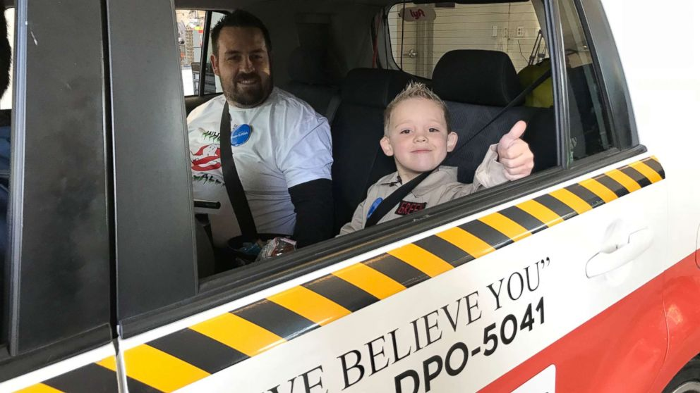 """London, 5, gives a thumbs up on his day as his """"Ghostbusters"""" wish comes true."""