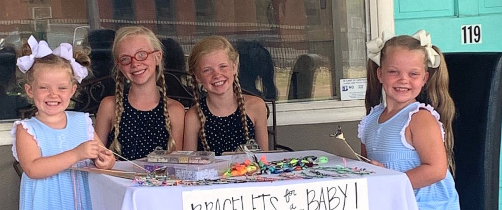 PHOTO: Evelyn, 4, Susanna, 11, Mary Anson, 11 and Eleanor Tate, 7, sit outside their mothers Mississippi salon making and selling bracelets in hopes to raise money so their parents can adopt a baby.