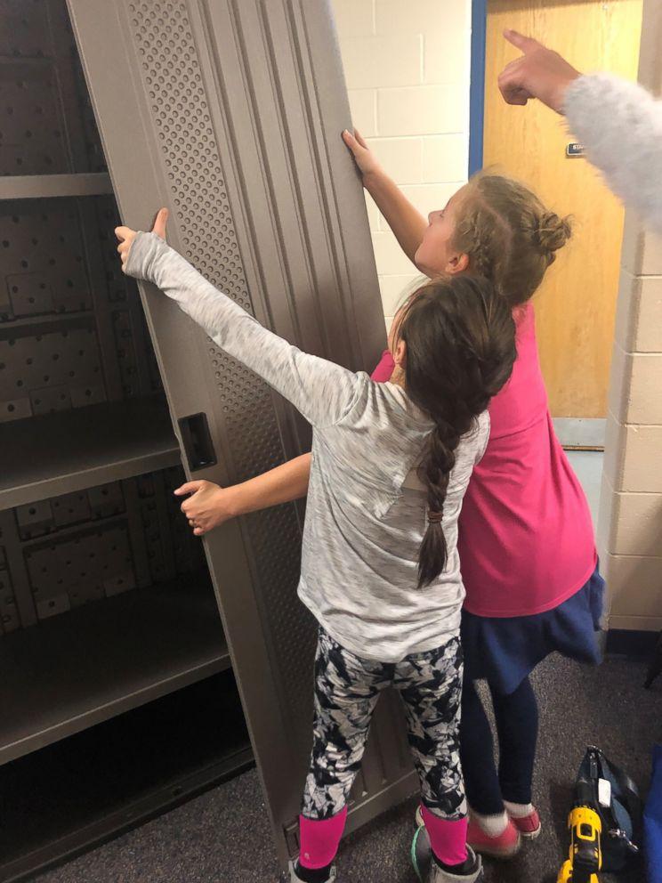 PHOTO: Girl Scouts of Western Ohio helped install a feminine hygiene locker in their school bathroom.