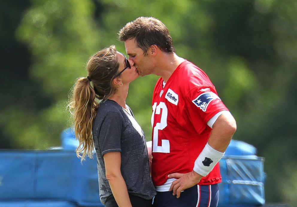 PHOTO: New England Patriots quarterback Tom Brady kisses his wife, Gisele Bundchen, following Patriots training camp at the Gillette Stadium practice facility in Foxborough, Mass., Aug. 3, 2018.