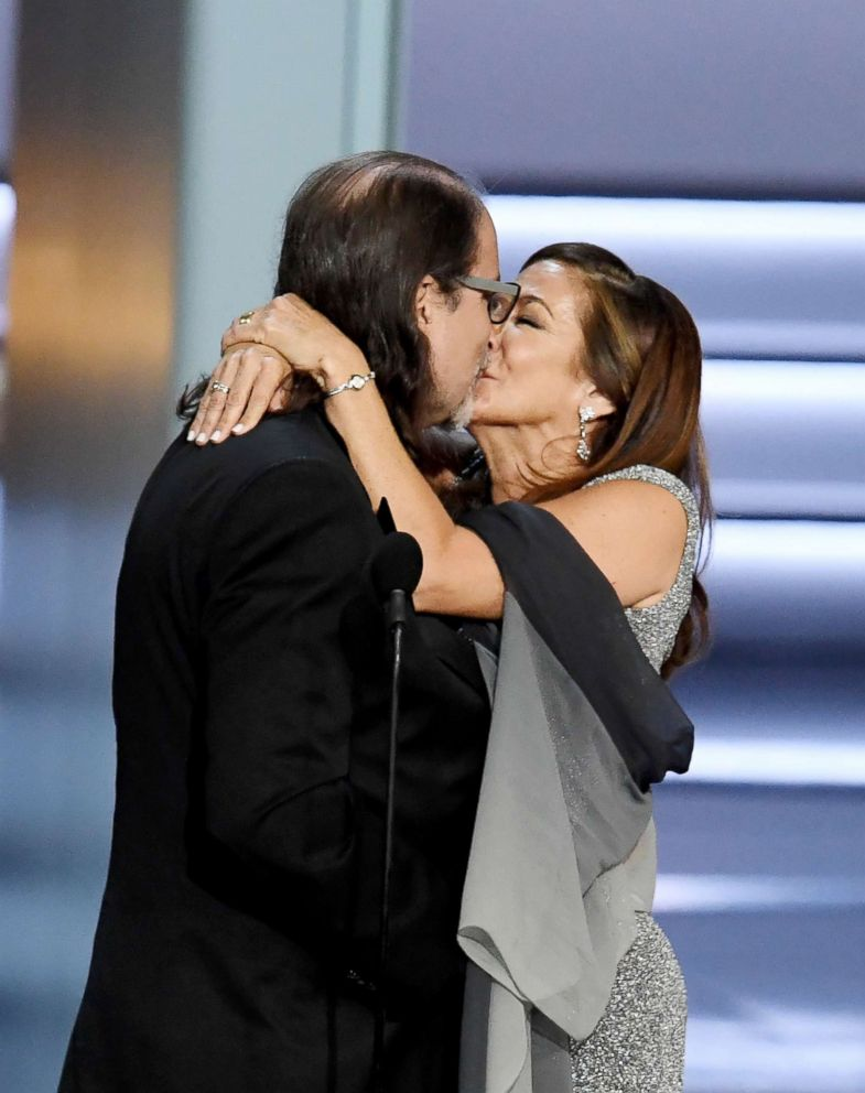 """Glenn Weiss  (L), winner of the Outstanding Directing for a Variety Special award for """"The Oscars,"""" and Jan Svendsen kiss after getting engaged during the 70th Emmy Awards on Sept. 17, 2018, in Los Angeles."""