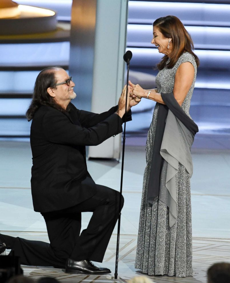 PHOTO: Glenn Weiss (L), winner of the Outstanding Directing for a Variety Special award for The Oscars, proposes marriage to Jan Svendsen during the 70th Emmy Awards on Sept. 17, 2018 in Los Angeles.