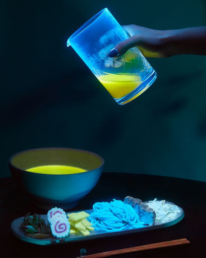 PHOTO: Broth being poured into a bowl for glow in the dark ramen.
